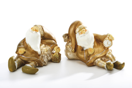 Two Santa Claus figurines