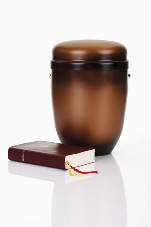 cremation: Cremation urn with bible and rosary Stock Photo