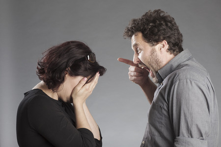 uptight: Mature couple quarreling man shouting woman crying