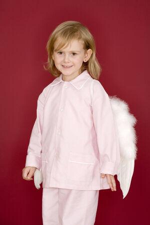 Little girl dressed as angel photo