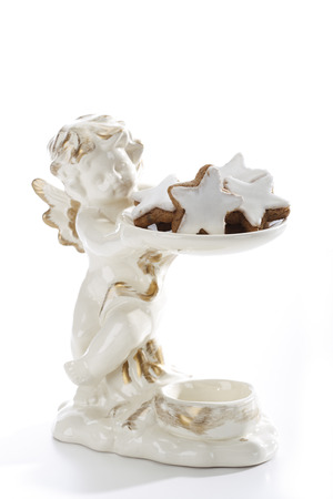 nack: Angel figurine with Star-shaped cinnamon biscuits Stock Photo