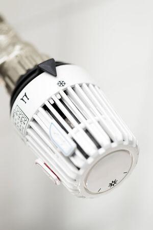 White radiator with white thermostat