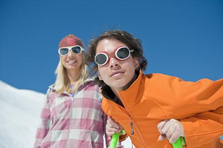 hairband: Austria, Salzburger Land, Altenmarkt, Zauchensee, Young couple wearing sunglasses in snowy landscape, portrait, close-up