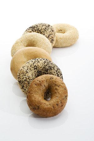 several breads: Bagels with poppy seeds bagels with sesame wholemeal bagels on white background