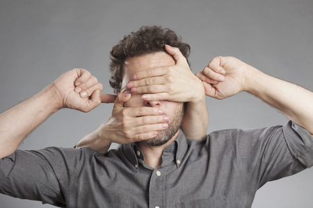 obscured: Man not seeing not hearing not saying anything Stock Photo