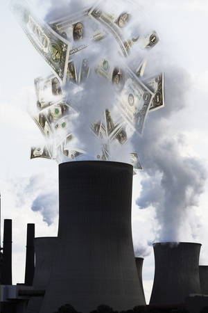 burning money: US dollar notes coming out of smoke stack
