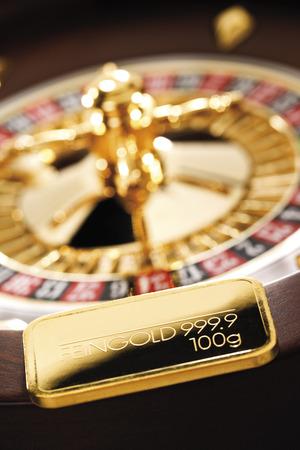 lingote de oro: Barra de oro en la rueda de la ruleta