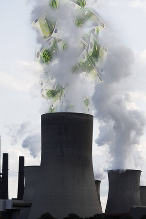 monetary policy: Euro notes coming out of smoke stack Stock Photo
