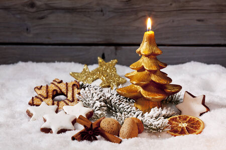 Christmas on pile of snow against wooden wall photo