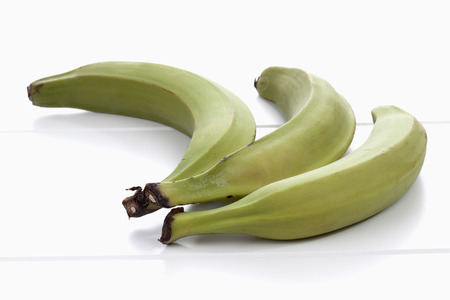 Three plantains on white background photo