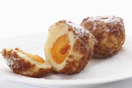 Apricot dumpling breaded, served on plate Reklamní fotografie