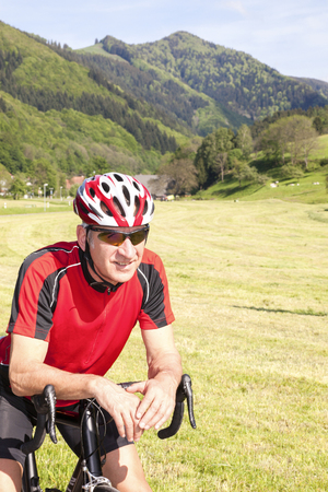 Mature man with racing bicycle, Freiburg, Germany photo