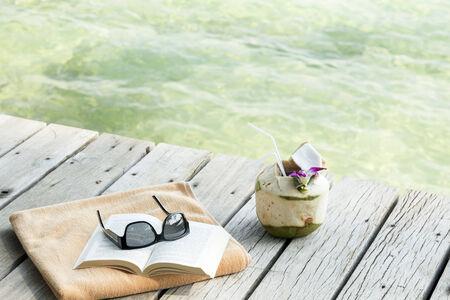 longdrink: Towel sunglasses book longdrink on pier Koh Samui Thailand