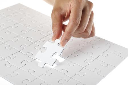 grouping: Hand finishing white puzzle