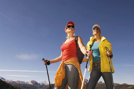 nordic walking: Two women in mountains, Nordic walking Stock Photo