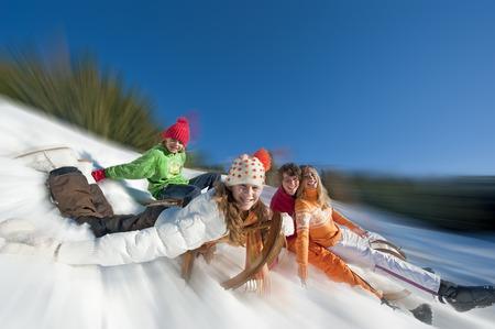 Austria, Salzburger Land, Altenmarkt, Family sledding photo