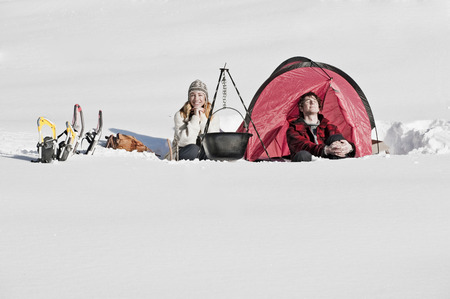 Austria, Salzburger Land, Couple camping in snow covered landscape photo