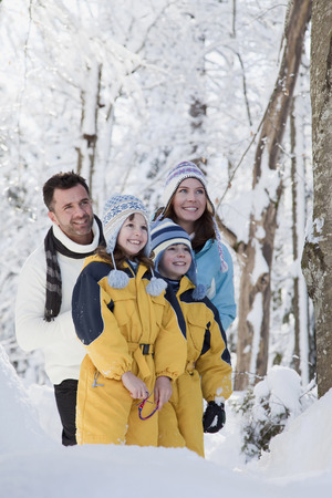 Germany, Bavaria, Family in winter clothes, portrait photo