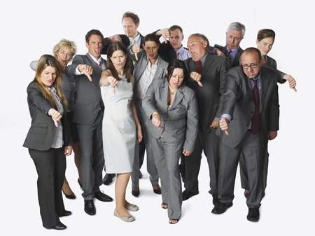 displeased businessman: Large group of businesspeople showing thumbs down on white background