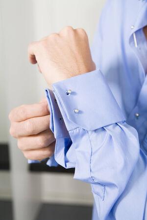 wrist cuffs: Man fastening cufflinks mid section close-up Stock Photo