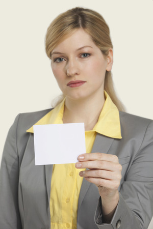 slicked: Businesswoman holding blank note