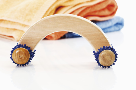Massage tool with towels in background photo