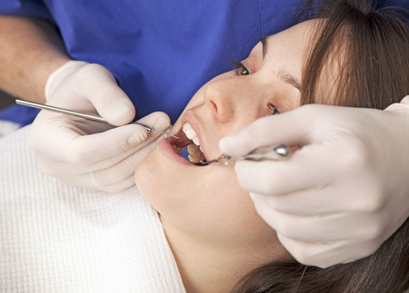 Young woman at dentist photo