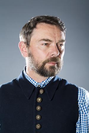 contemplative: Contemplative mature man against gray background Stock Photo