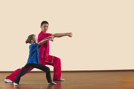 imitating: Kung Fu, Changquan, Gongbu shuang chongquan, Long Fist Style, Kung Fu instructor and girl Stock Photo