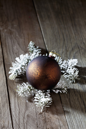 fir twig: Christmas bauble with fir twig on wooden background