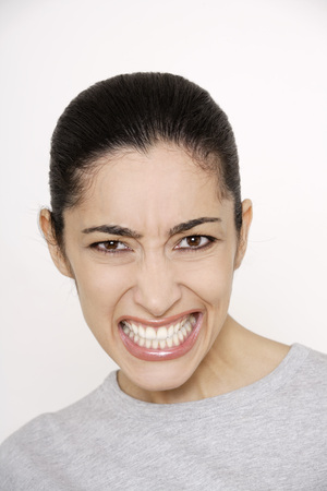 slicked: Young woman, snarling, portrait