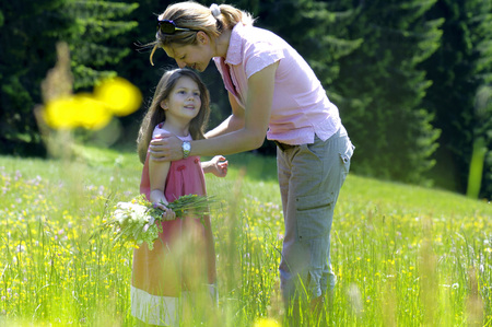 Mother and daughter in summer meadow photo