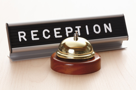 clang: Reception sign with service bell on desk