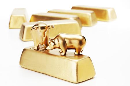 Golden bull bear figurine on gold bars