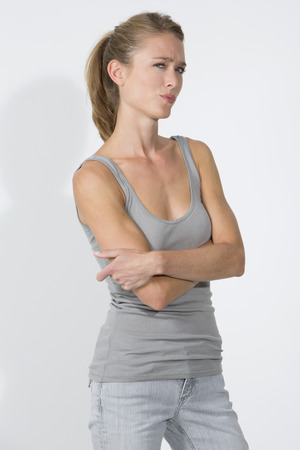 sceptic: Skeptical young woman against white background