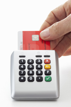 Person using credit card reader photo