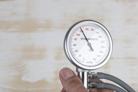 blood pressure gauge: Close up of hand holding blood pressure gauge