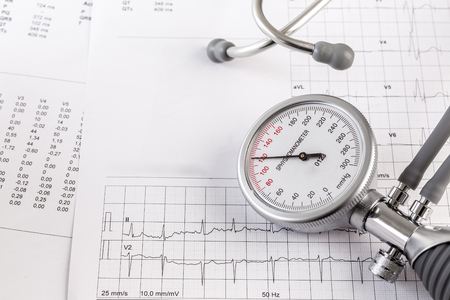 blood pressure gauge: Salt consuming can increase blood pressure, pile of salt, blood pressure gauge on ecg record