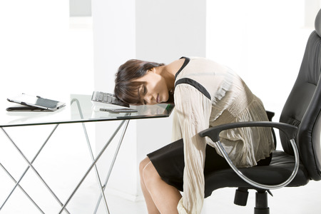 overstress: Young businesswoman at office