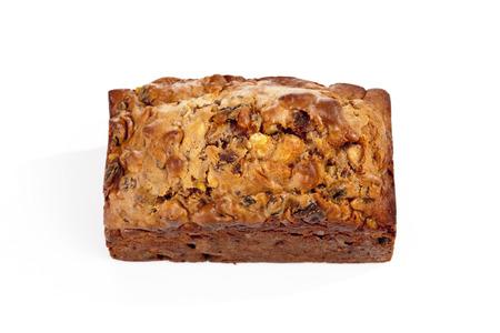 fruitcake: traditional fruitcake on white background