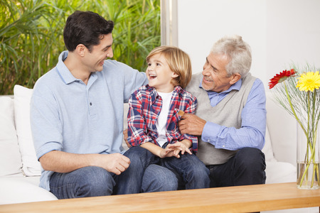 caucasian: Grandfather, father and son at home together Stock Photo