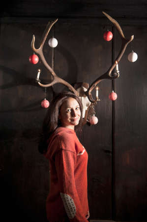 mrs: Mrs. Claus decorating antlers Stock Photo