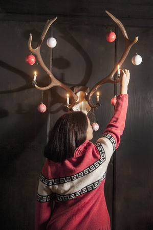 mrs  claus: Mrs. Claus decorating antlers Stock Photo