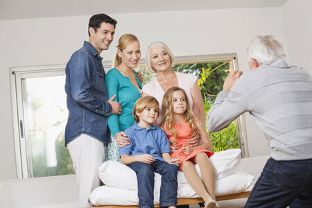 Extended family taking group photo at home Stock Photo