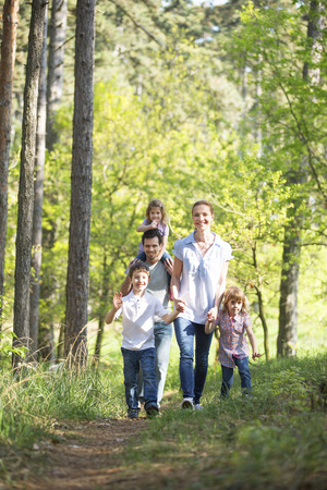 happy family taking a walk in forest