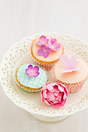 gum paste: Cupcakes decorated with fondant and gum paste flower