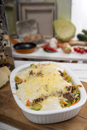 mincemeat: Cabbage casserole with mincemeat, bechamel sauce and cheese