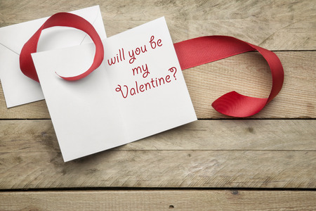 love proof: Card Will you be my valentine on wooden background