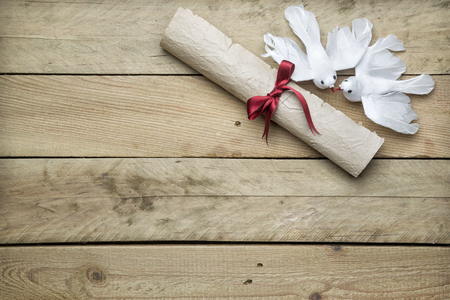 Letter paper and peace doves on wooden background Stock Photo