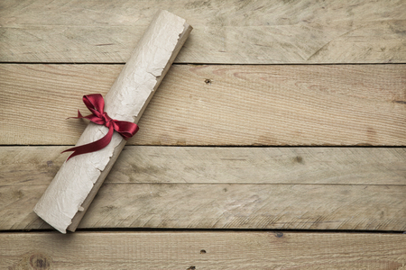 Letter paper on wooden background